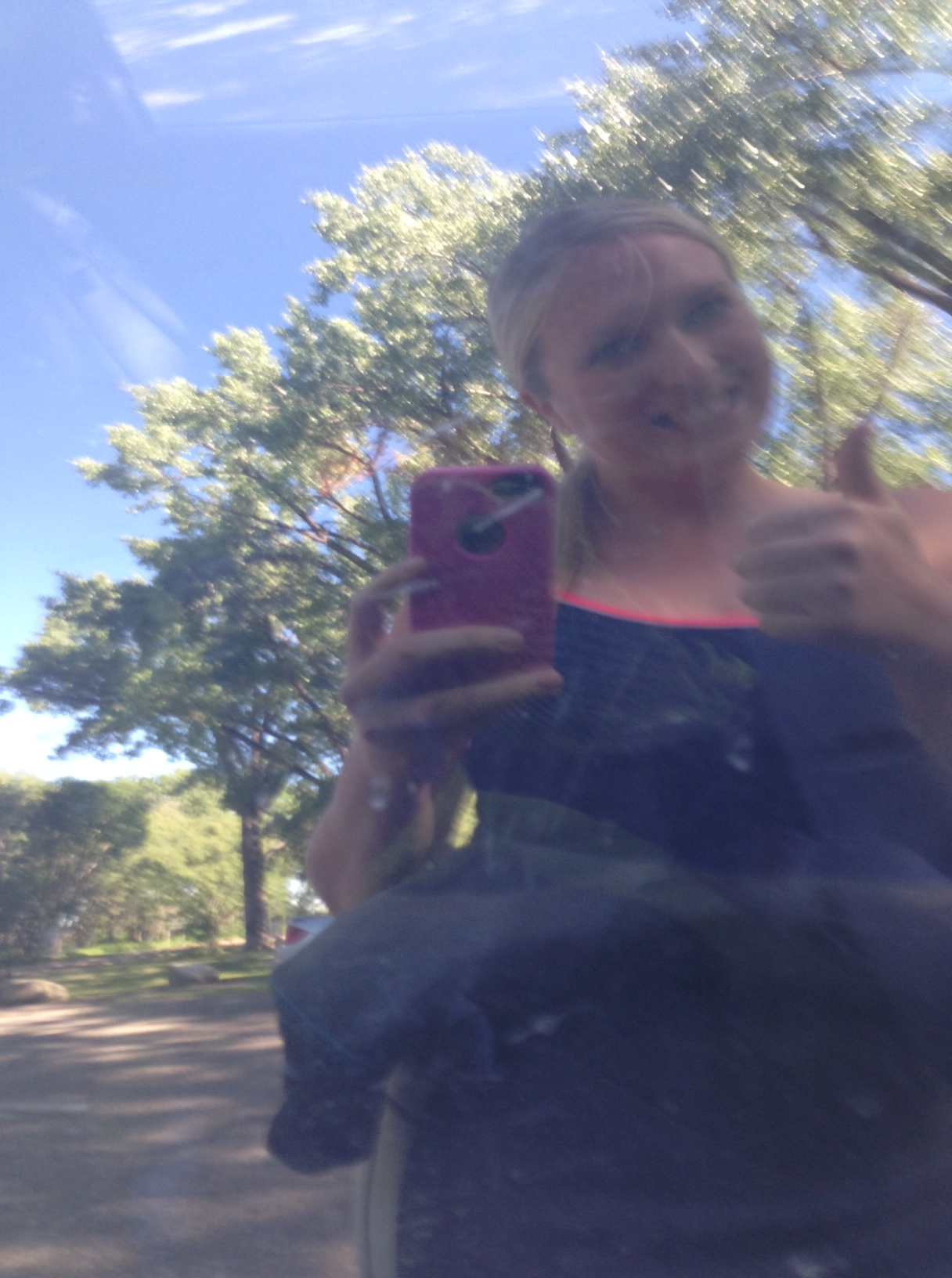 Car window selfie in my swimsuit and wetsuit